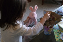 Princess showing off her completed bouquet to her bunny. She was really proud of her handiwork.